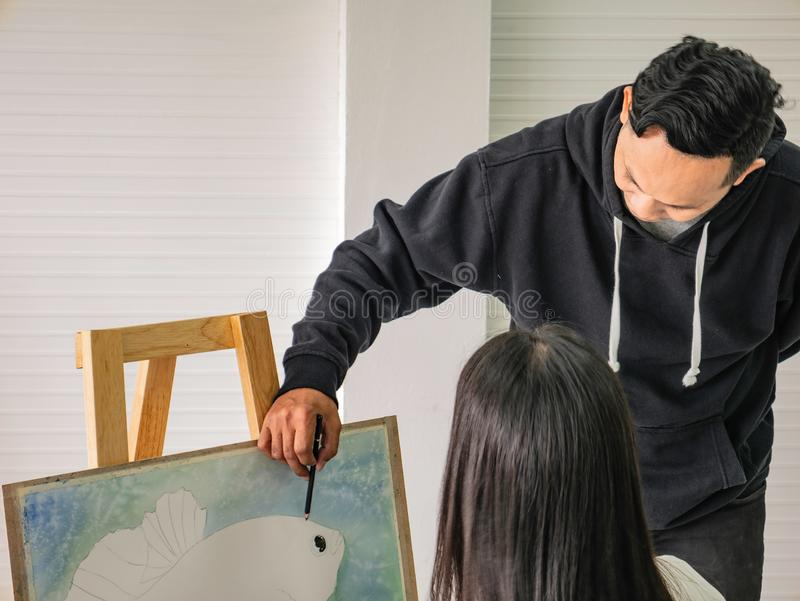 Handsome Young Asian man or water color artist Teaching how to paint and artist student Learning the class royalty free stock photos