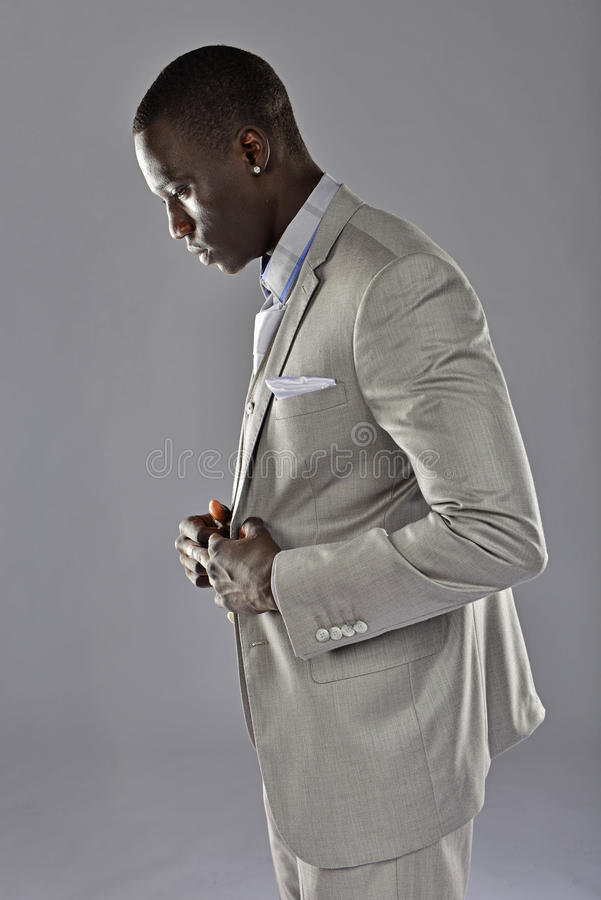 Download Black Man In A Suit Adjust His Coat Stock Photo - Image: 30285260
