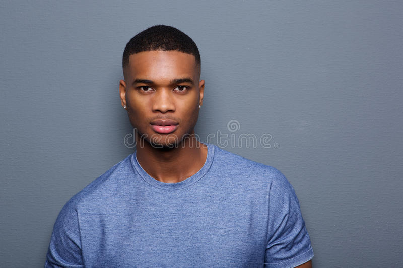 Handsome young black man with serious expression on face stock photography