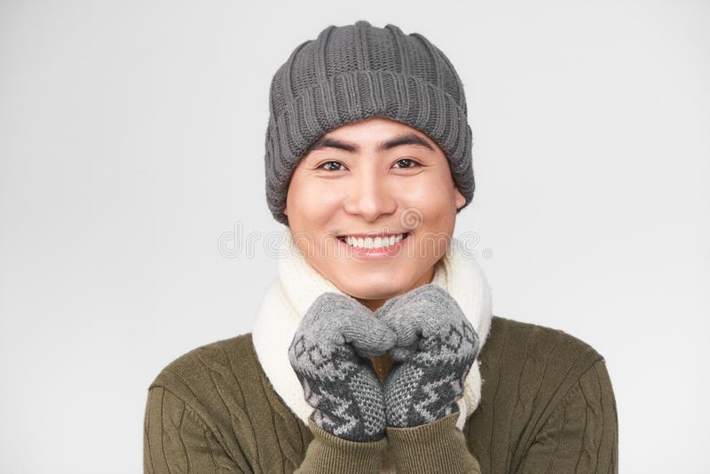 Handsome young boy freezing in warm clothing with copy space.  royalty free stock image