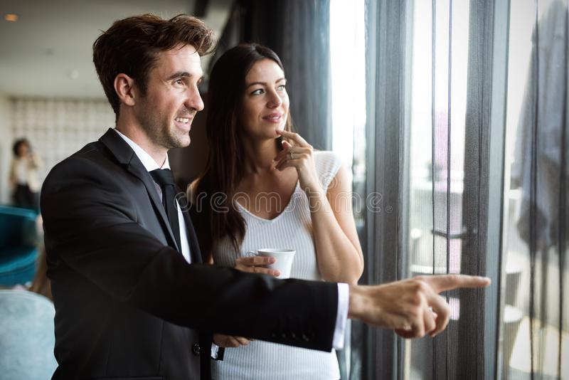 Handsome business man explaining his vision or idea to colleague. Handsome young business men explaining his vision or idea to colleague royalty free stock photos
