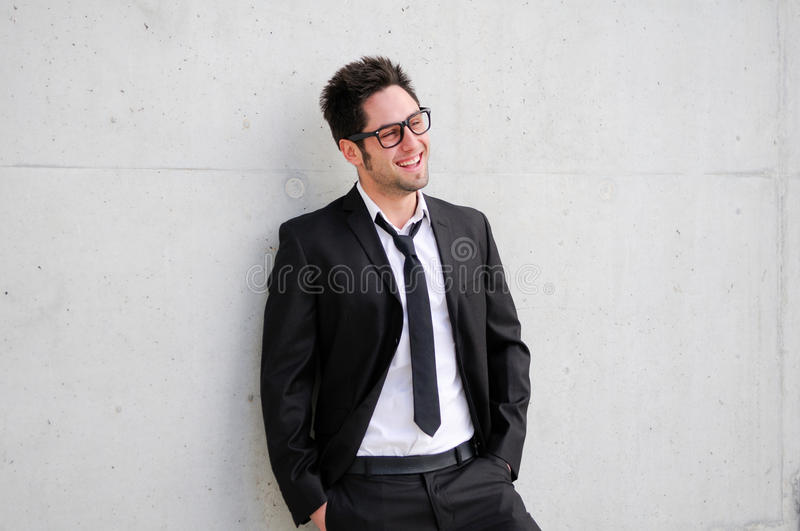 Handsome young business man smiling royalty free stock images