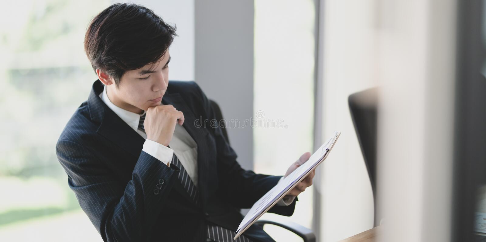 Young businessman checking the data on the document preparing before meeting royalty free stock photos
