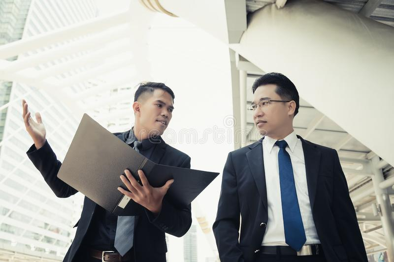 Handsome young businessman disagree, disappoint his boss. They h stock photo
