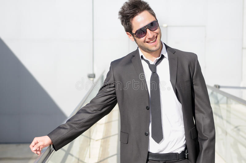 Handsome young businessman laughing stock photography