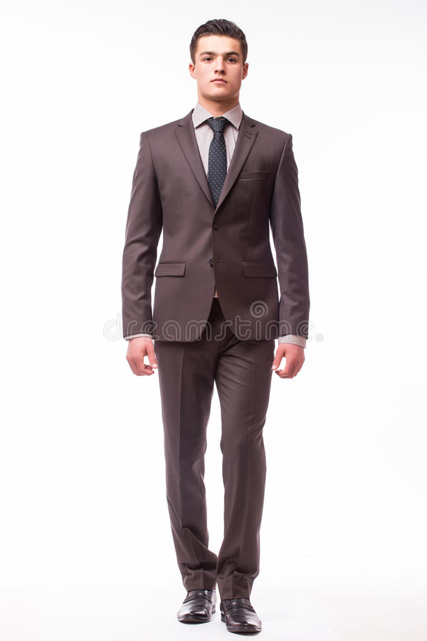 Handsome young businessman with luck in suit royalty free stock images