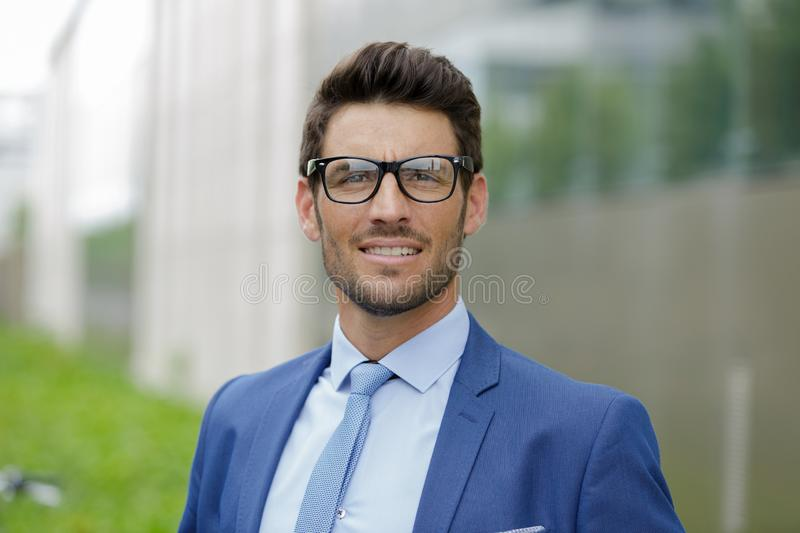 Handsome young businessman outdoors royalty free stock photos