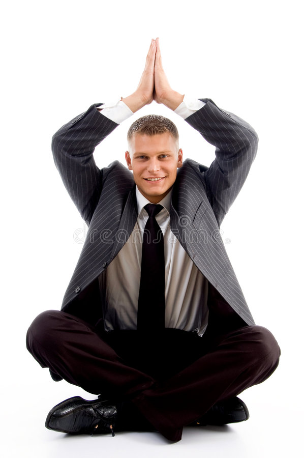 Handsome young businessman performing yoga stock photography