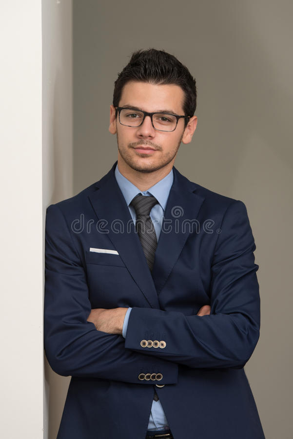 Download Handsome Young Businessman Portrait In His Office Stock Photo - Image: 43253694