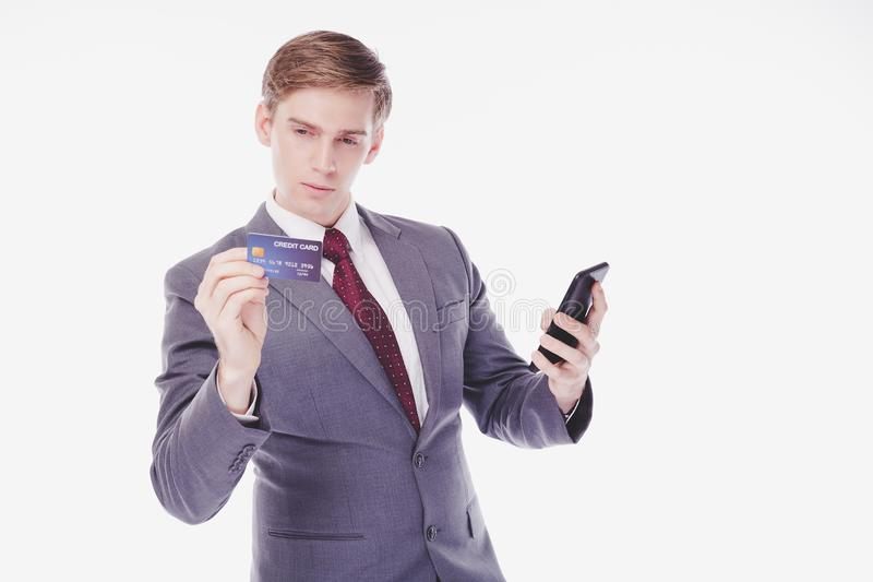 Handsome young businessman read security code, putting the code for paying, buying product, book ticket, favorite things from stock images