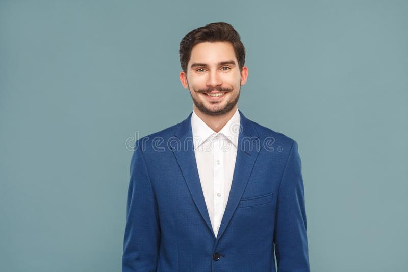 Handsome young businessman toothy smiling royalty free stock photos