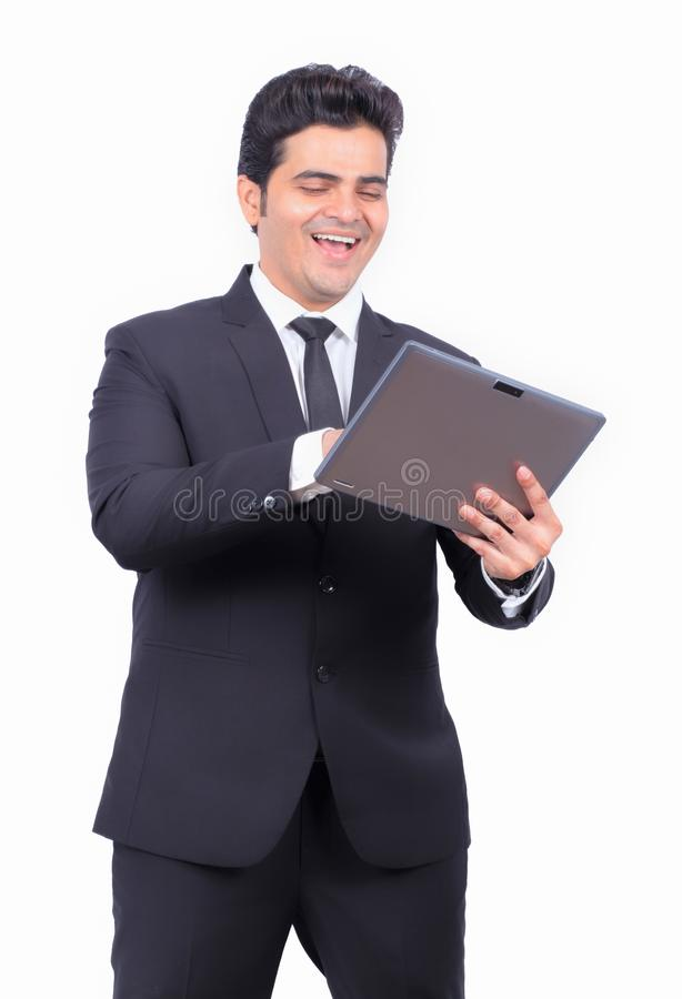 Handsome young businessman using digital tablet on white background stock photos