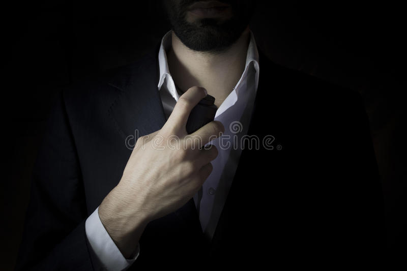 Handsome young businessman using perfume stock photos