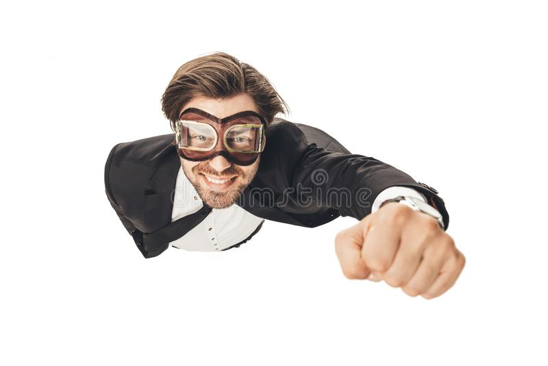 handsome young businessman in vintage aviation goggles flying like superhero royalty free stock image