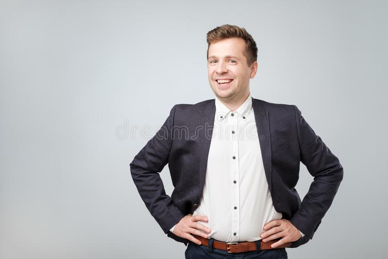 Handsome young caucasian businessman looking at camera. royalty free stock photography
