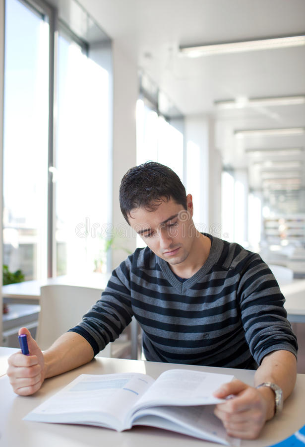 Download Handsome Young College Student In A Library Royalty Free Stock Photo - Image: 18003405