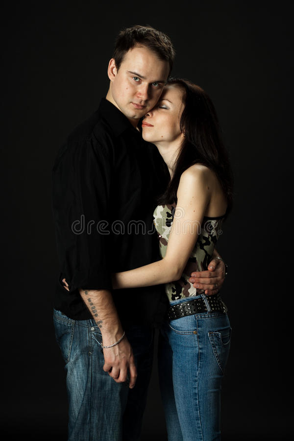 Handsome young couple posing in studio stock photos