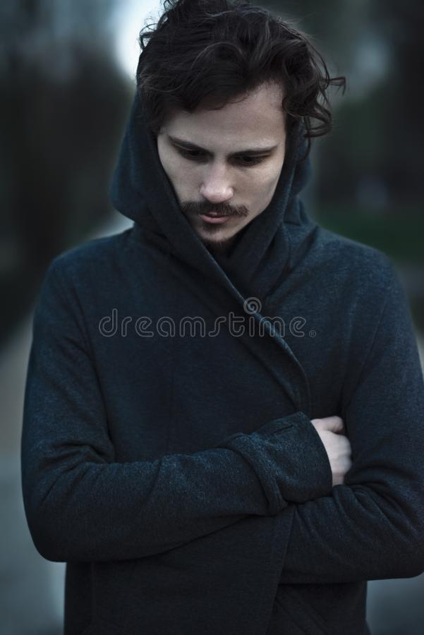 Handsome young curly man has deep thoughts royalty free stock images