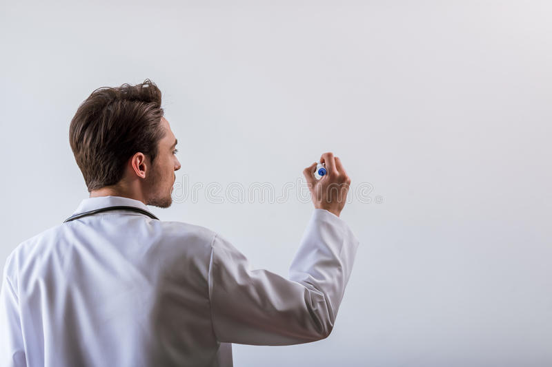 Handsome young doctor royalty free stock photos