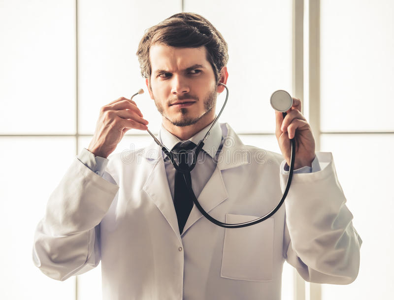Handsome young doctor royalty free stock photography