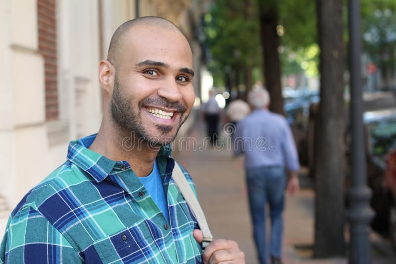 Handsome young ethnic man smiling with copy space royalty free stock photo