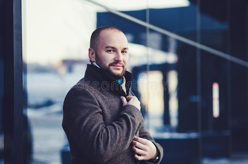 Handsome young fashion model posing on city streets royalty free stock image
