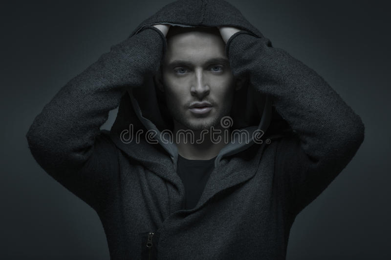 Handsome young fashionable guy with hoodie. Handsome fashionable guy with hoodie royalty free stock image