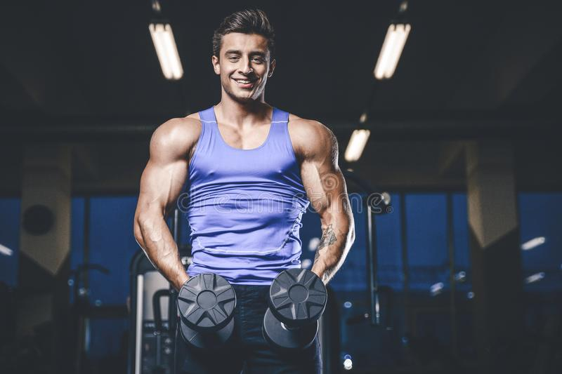 Handsome model young man workout in gym stock photos