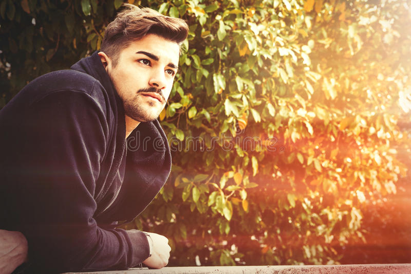 Handsome young harmony italian man - Romantic waiting stock photography