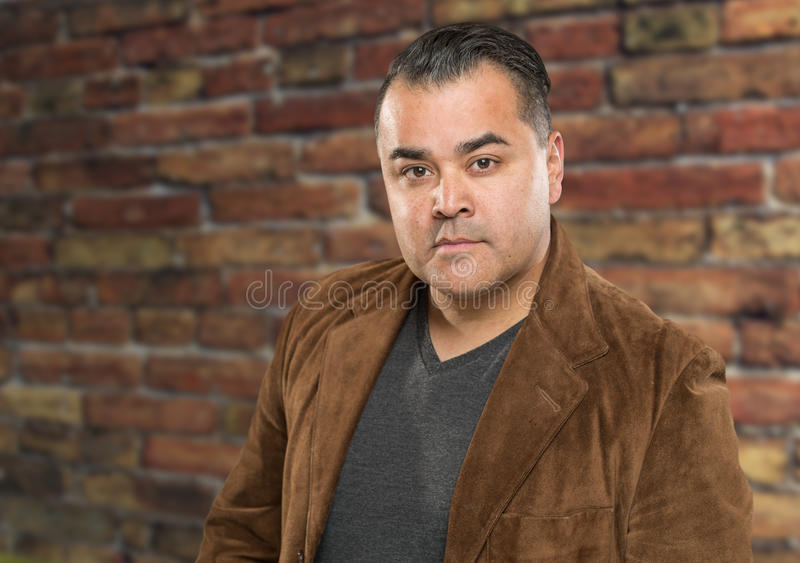 Handsome Young Hispanic Male Headshot Portrait Against Brick Wal. L stock images
