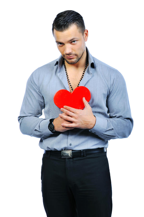 Handsome macho man holding love heart portrait - isolated royalty free stock images