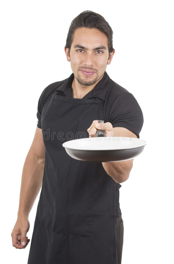 Handsome young male chef wearing black apron royalty free stock images