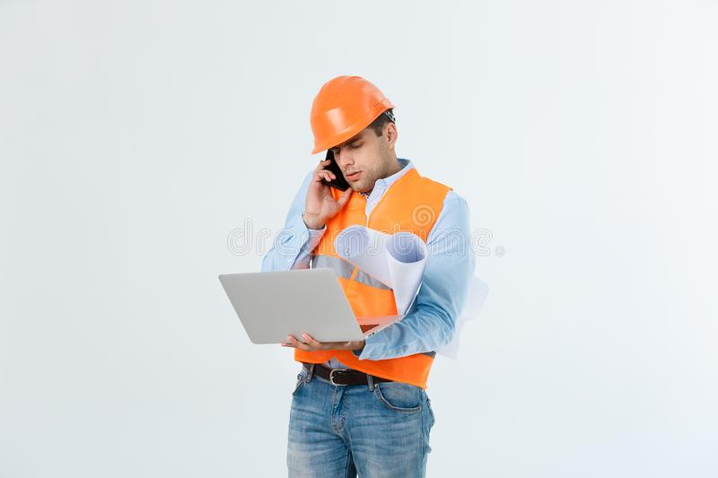 Handsome young male engineer with busy working on engineering project stock photography