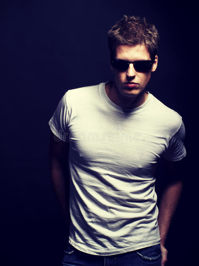 Handsome young male model with sunglasses royalty free stock photo