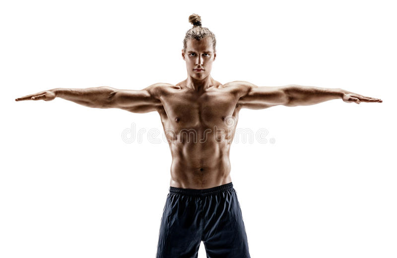 Handsome young male with perfect body performs fitness exercises on white background. royalty free stock photography