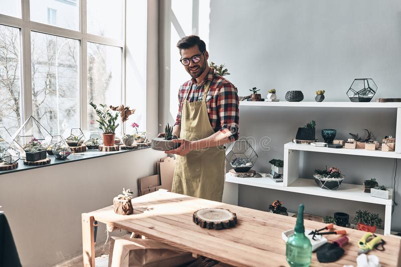 He turned his hobby into business. stock images