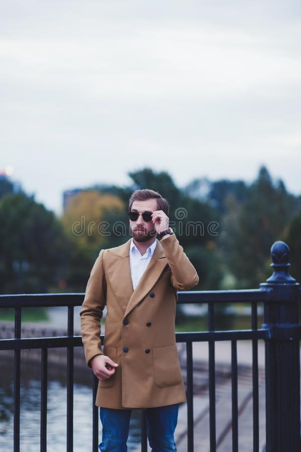 Handsome young man in autumn coat royalty free stock photo