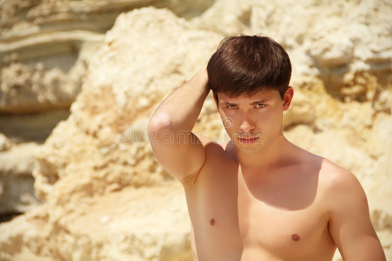 Handsome Young Man On Beach Background Royalty Free Stock Images