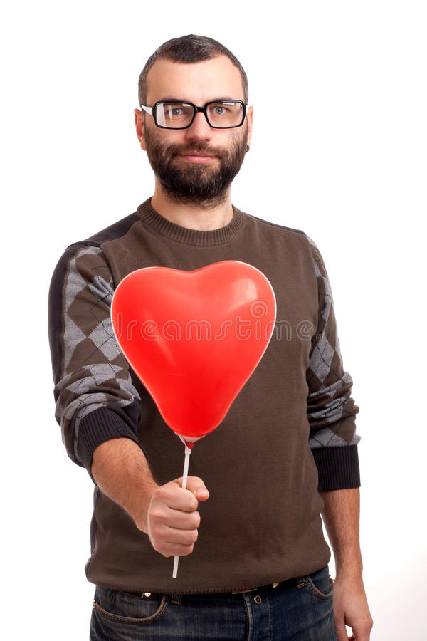 Download Handsome Young Man With Beard Holding Red Balloon Stock Photo - Image: 28884592