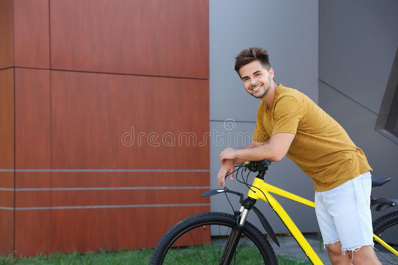Handsome young man with  on city street. Space for text royalty free stock photo