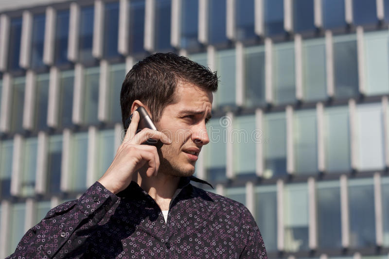 Handsome young man calling royalty free stock photography