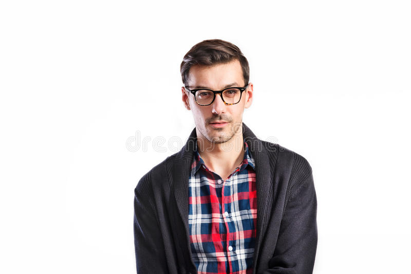 Handsome young man in checked shirt. Studio shot, isolated. stock images
