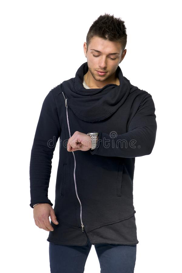 Handsome young man checking watch on his wrist royalty free stock photography
