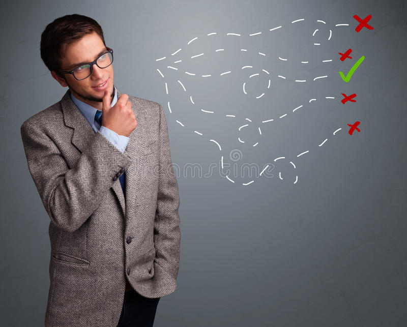 Young man choosing between right and wrong sings. Handsome young man choosing between right and wrong sings royalty free stock image