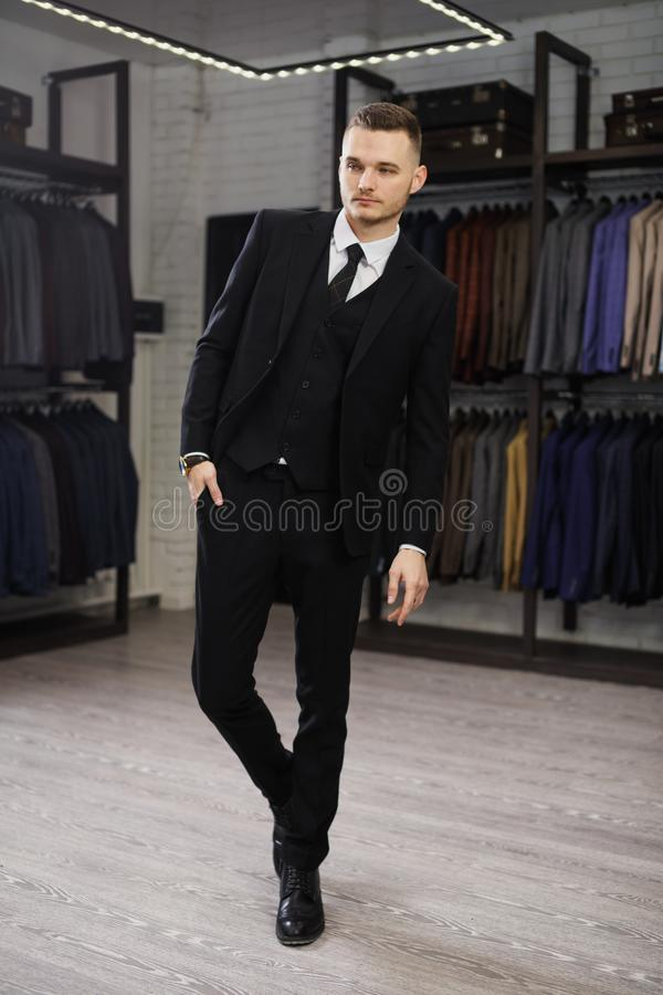 Modern businessman. Fashion shot of a handsome young man in elegant classic suit. Perfect to the last detail. Men`s royalty free stock image
