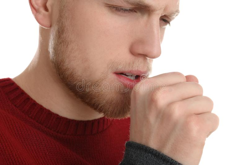 Handsome young man coughing against white. Background royalty free stock images