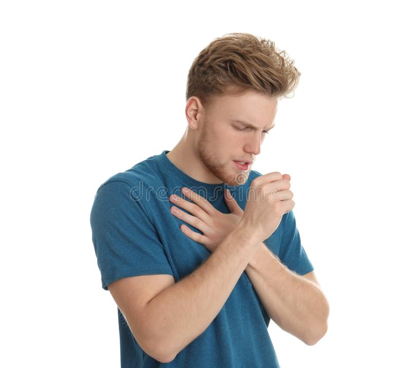 Handsome man coughing against white background. Handsome young man coughing against white background royalty free stock images