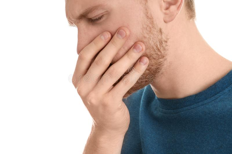 Handsome young man coughing. Against white background stock photo