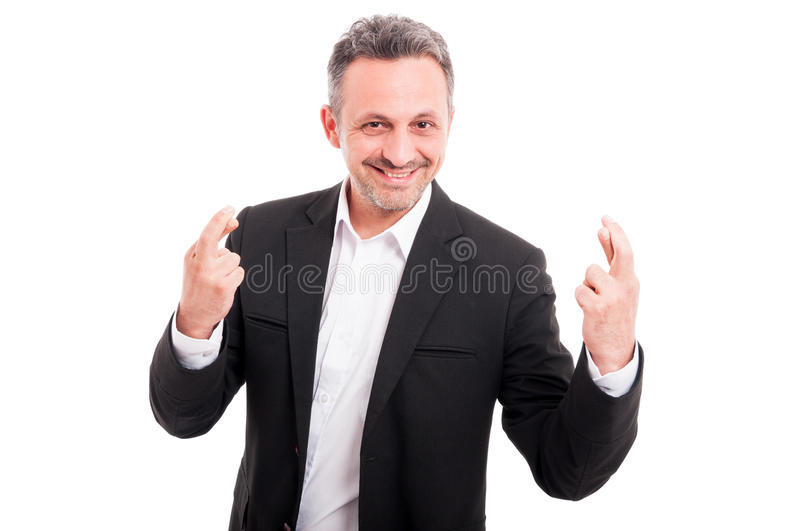 Handsome young man with crossed finger royalty free stock photo