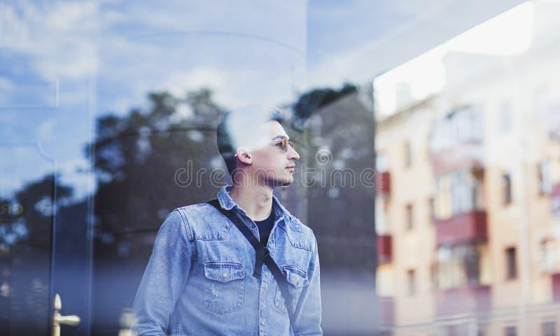 Young man in denim shirt stock image